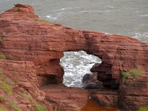 Cliff in Arbroaht. Coastal rock cliff with the lumen of the sea in Arbroath, Scotland Stock Photo