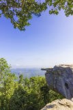 Cliff with blue sky. The cliff at the national park surrounded with mountains and blue sky with white clouds Royalty Free Stock Photos