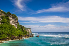 A Cliff, Blue Water and Clear sky Stock Photo