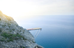 Cliff Into Blue Water. Springboard for a diving from a rock Stock Photography