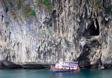 Cliff. Boat in front of the cliff Royalty Free Stock Photos