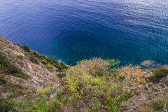 Cliff in Budva. View from edge of the hill with Mogren Fortress in Budva city, Montenegro Royalty Free Stock Photography