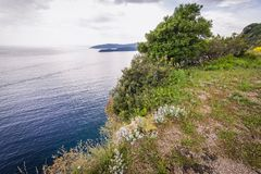Cliff in Budva. View from edge of the hill with Mogren Fortress in Budva city, Montenegro Stock Photo