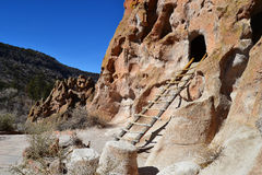 Cliff Cave Dwelling with Ladder. Cliff cave dwelling along the canyon at Bandelier National Monument in New Mexico Royalty Free Stock Photography