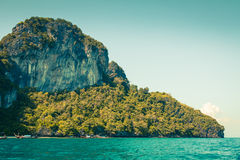 Cliff and the clear sea with a boat near Phi Phi island in south Royalty Free Stock Image