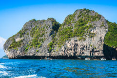 Cliff and the clear sea with a boat near Phi Phi island in south. Of Thailand Asia Stock Images