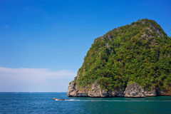 Cliff and the clear sea with long-tail near Phi Phi island in south of Thailand Royalty Free Stock Images