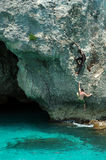 Cliff climbing in Jamaica. Two men climb a seaside cliff in Jamaica Royalty Free Stock Photo