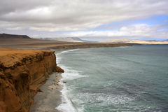 Cliff coast of Atacama desert near Paracas in Peru Royalty Free Stock Image