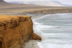 Cliff coast of Atacama desert near Paracas in Peru Stock Photos