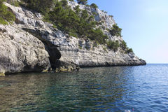 Cliff on the coast of Menorca Stock Images