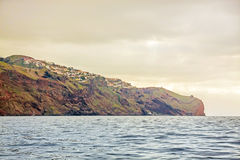 Cliff coast off town Canico, Madeira Royalty Free Stock Photography