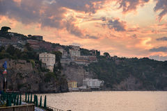 Cliff coast in Sorrento town at sunset. View of cliff coast in Sorrento town in southern Italy at sunset Royalty Free Stock Images