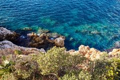 Free Cliff Coast With Beautiful Blue Water Royalty Free Stock Image - 137919846