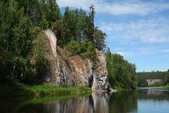 Cliff `Crest Rock` on the shore of Chusovaya river. Cliff `Crest Rock` on the shore of Chusovaya river, Sverdlovsk Region, Russia Royalty Free Stock Photo