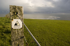 Cliff edge. A warning sign on the rugged Northumberland coast royalty free stock photos