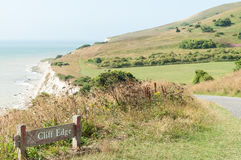 Cliff edge danger sign, South Downs Way, nr Eastbourne, UK Royalty Free Stock Images