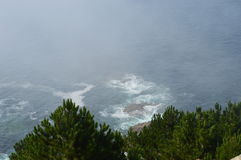 Cliff edge. Morning Mist covers Cliff Village Royalty Free Stock Photos