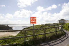 Cliff edge please keep to footpath sign Royalty Free Stock Image