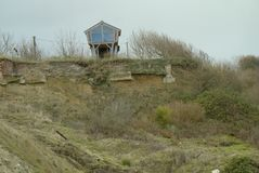Cliff erosion and living on the edge. stock images