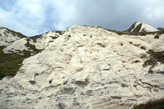 Cliff face. Looking up at a white chalk cliff face stock photography
