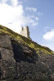 Cliff face view of castle ruins stock image