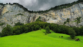 Cliff face and waterfall in Lauterbrunnen, Switzerland Royalty Free Stock Photography