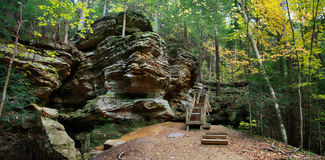 Ash Cave Cliffs. A Cliff Face And Wooden Stairs In Autumn At Ash Cave In The Hocking Hills Region Of Central Ohio, USA Royalty Free Stock Photos