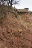 Cliff fall aftermath, Sidmouth. Collapse of red sandstone cliffs December 2012 at Sidmouth, Devon, England, United Kingdom Royalty Free Stock Images