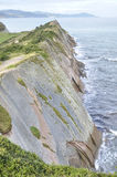Cliff formed by the Flysch, Northern Spain Royalty Free Stock Photo