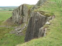 Cliff at Hadrians Wall. Hadrians Wall in England is a huge wall going from the westside to the eastside og England at the boarder to Scotland. The built uses the Royalty Free Stock Photo