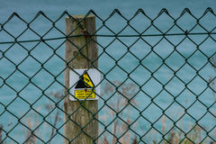 Cliff hazard sign on post Royalty Free Stock Images