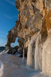 Cliff with a hole like a heart covered with ice splashes. On Baikal lake Stock Photos
