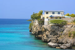 Cliff house. A house perched on a cliff in Curacao stock image