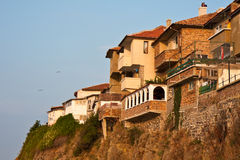 Cliff Houses at Sunset. Houses on a steep cliff in Sozopol, Bulgaria Royalty Free Stock Photos