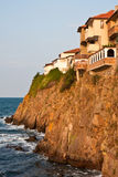 Cliff Houses at Sunset. Houses on a steep cliff in Sozopol, Bulgaria Stock Photo