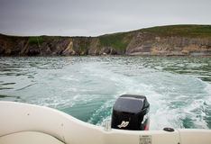 Cliff Ireland Atlantic Sea Celtic Fishing fish boat water Stock Image