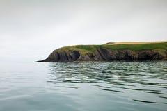 Cliff Ireland Atlantic Sea Celtic Fishing fish boat water Royalty Free Stock Images
