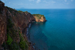 Cliff island sea Stock Images