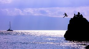 Cliff jumping in hawaii Royalty Free Stock Images