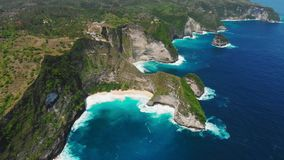 Cliff and Kelingking beach with blue ocean on Nusa Penida Island. Aerial drone view. Cliff and Kelingking beach with blue ocean on Nusa Penida Island. Aerial stock video