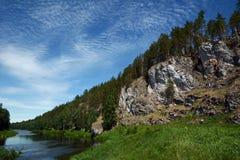 Cliff `Korchagi Rock` on the shore of Chusovaya river. Cliff `Korchagi Rock` on the shore of Chusovaya river, Sverdlovsk Region, Russia Stock Images