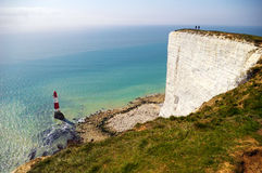 Cliff and lighthouse. Lighthouse below the coastal cliffs called Seven Sisters in UK Royalty Free Stock Image