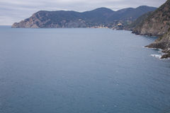 The cliff of the Ligurian coast. In Cinque Terre, Italy Royalty Free Stock Photo