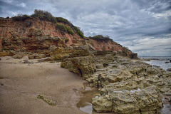 Cliff. Low tide leaves outdoors a rocky area that is normally under water Stock Images