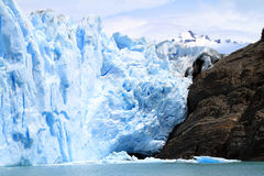 Glacier and Rock Cliff Stock Image