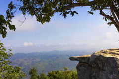 Cliff at the national park. The cliff at the national park in Thailand with the view of mountains and sky with white clouds Royalty Free Stock Photography