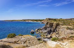 Cliff near Carloforte Island of San Pietro, Carbonia-Iglesias,. View of the cliff and the blue sea near Carloforte Island of San Pietro, Carbonia-Iglesias Stock Image