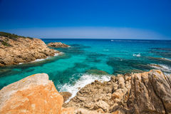 Cliff near Chia beach with azure water, Sardinia, Italy Stock Images