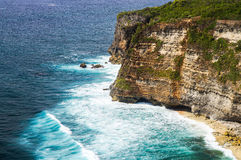 Cliff near the ocean. Uluwatu Bali. The cliffs and the ocean near the Uluwatu Temple on Bali, Indonesia. waves crashing against the cliff Stock Photography